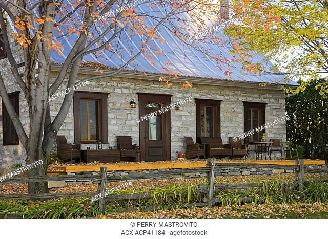 Old Canadiana circa 1750 cottage style fieldstone Residential Home in autumn, Quebec, Canada