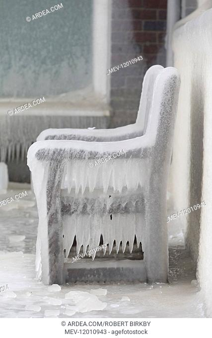 Thick ice formed over a seat beside Hollingworth Lake - near Rochdale, UK