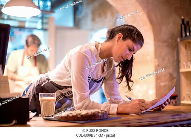 Restaurant owners working in kitchen