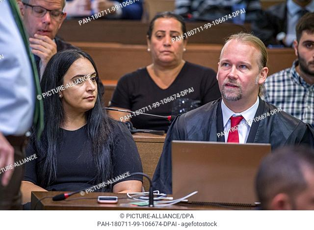 11 July 2018, Munich, Germany: Gamze Kuba·ik, daughter of Mehmet Kuba·ik, who was murdered in Dortmund, sits in the courtroom with her lawyer