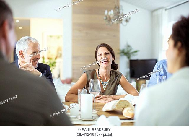 People talking at dinner party