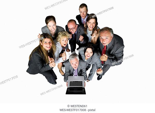 Business people with laptop against white background, portrait