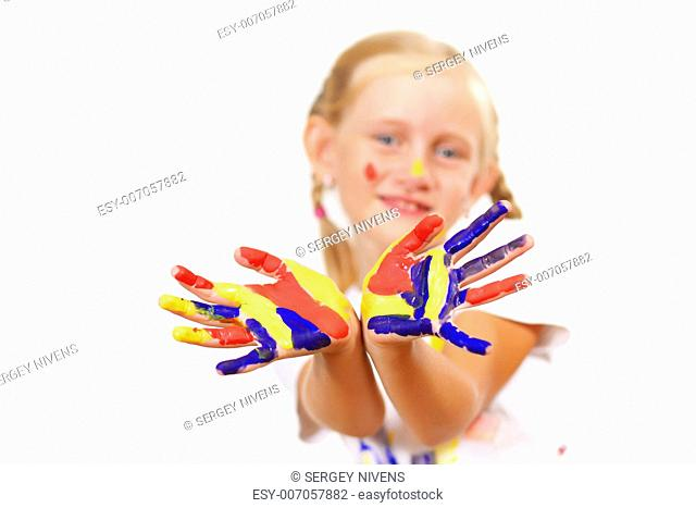 little child with hands painted in colorful paints ready for hand prints