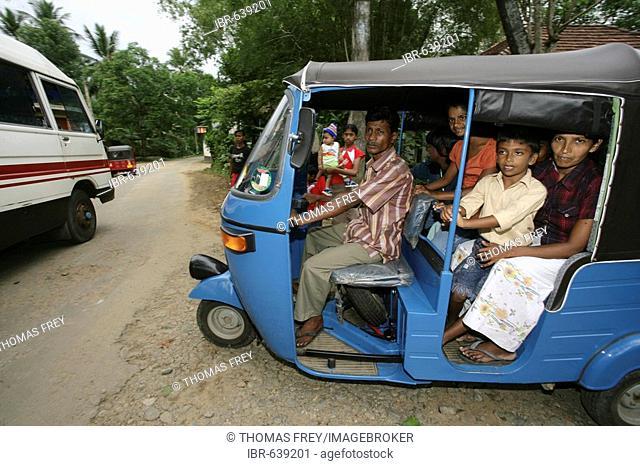 Tuk-tuk loaded with passengers in Hanwella, Sri Lanka, South Asia