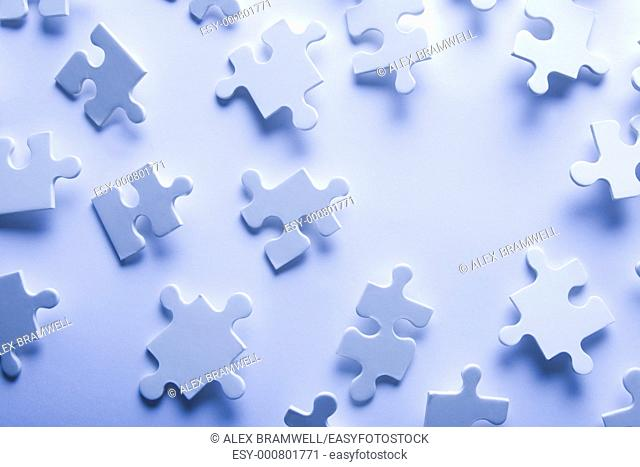Puzzle pieces in high key with a space for copy