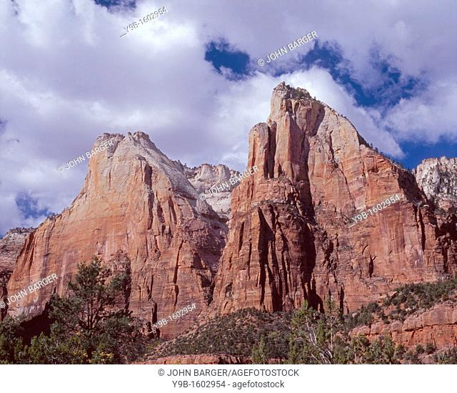 Cumulus clouds drift over Mt Abraham left and Mt Isaac right, above the Court of the Patriarchs, Zion Canyon, Zion National Park, Utah, USA