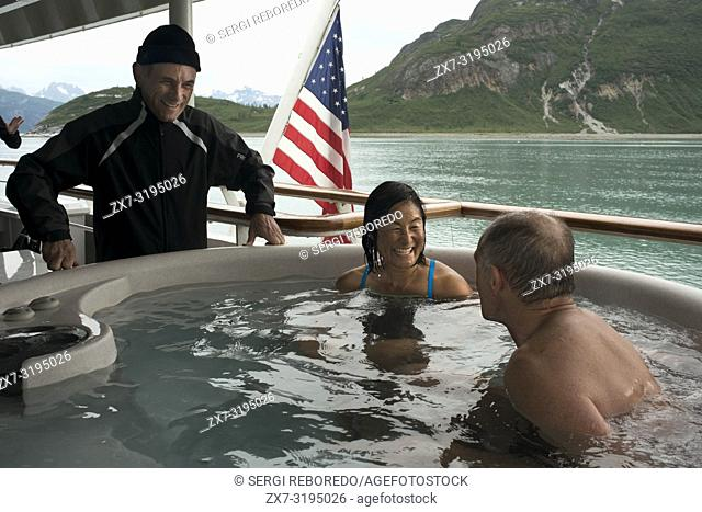 Passengers enjoying hot tub on cruise ship Safari Endeavour anchgored Scenery Cove Thomas Bay Tongass National Forest Alaska USA