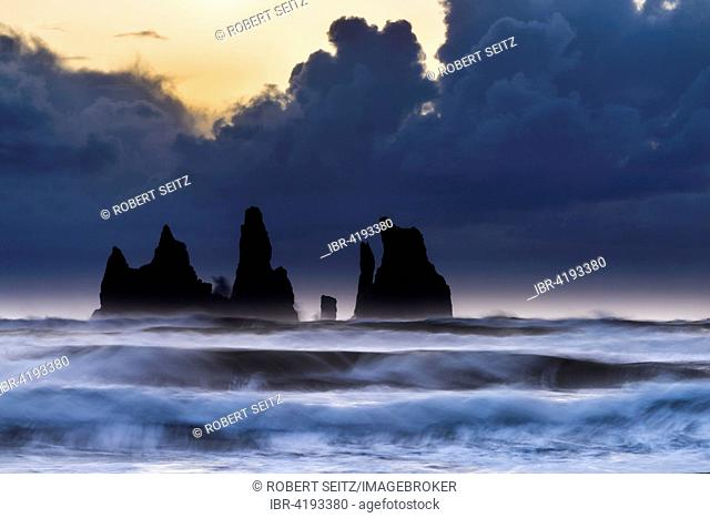 Reynisdrangar at sunset with ocean surf, near Vik, Southern Region, Iceland