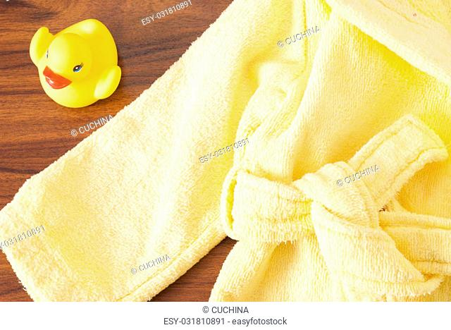 rubber ducky and a children's bathrobe on the table