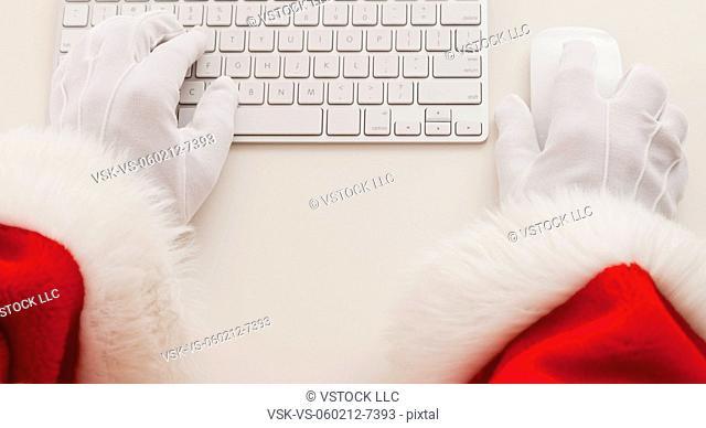 USA, Illinois, Metamora, Santa claus typing on keyboard