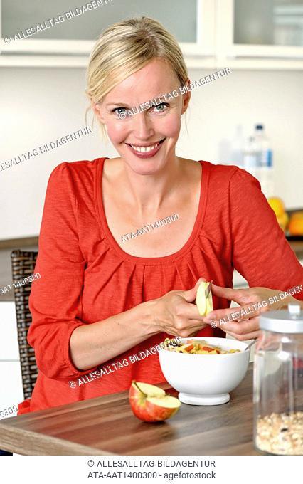 Woman is preparing her muesli