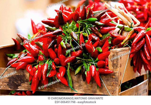 Big bunch of red hot chili pepper at outdoors market