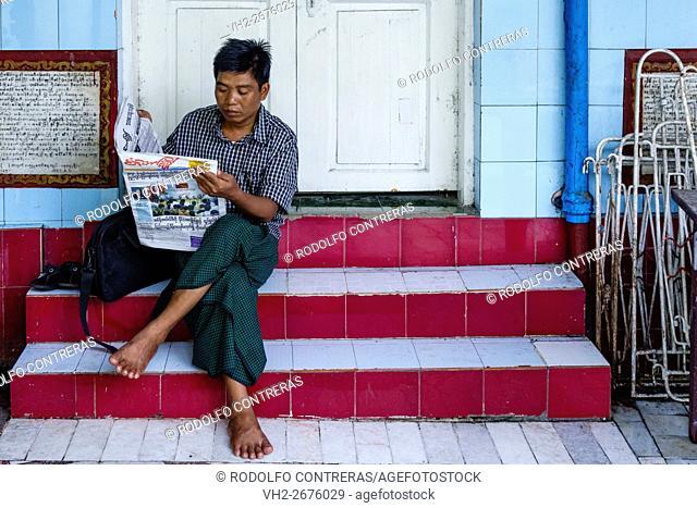 Man at the temple in Yangon, Myanmar