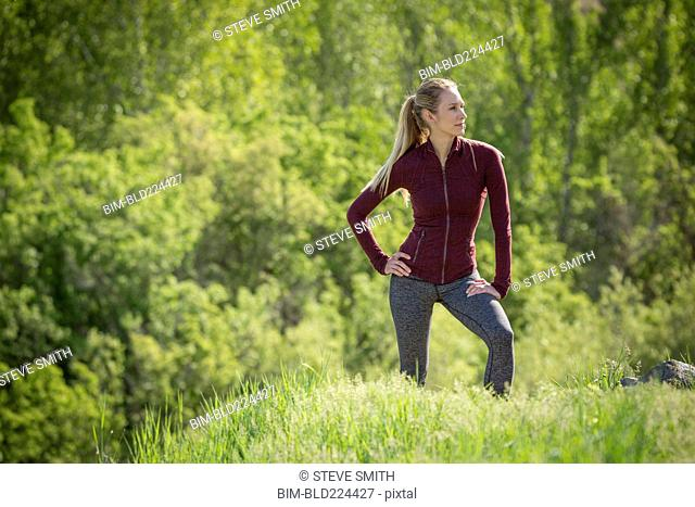 Caucasian woman standing on hill