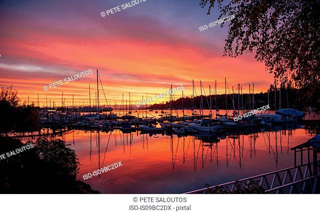 Boats in harbour at sunset, Bainbridge, Washington, USA