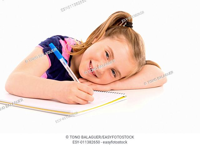 Blond kid indented girl student with spiral notebook in pupil desk