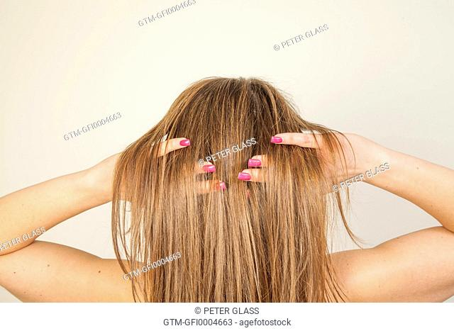 Woman with fingers in her hair