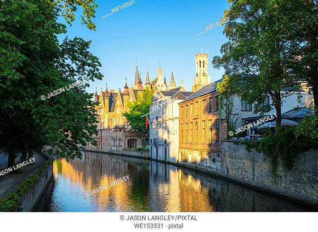 Belgium, West Flanders (Vlaanderen), Bruges (Brugge). Brugse Vrije and buildings along the Groenerei canal at dawn