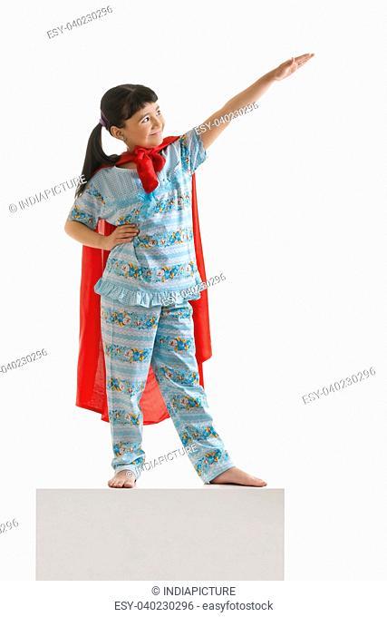 Girl pretending to be superman