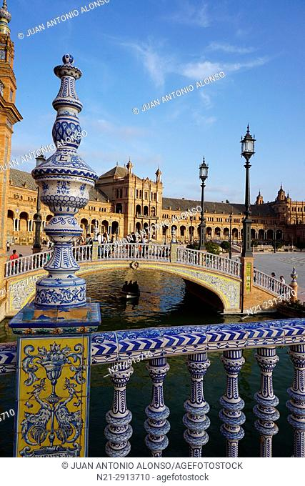 Arched buildings of a neo-renaissance palace in the shape of a semi-circular theatre and two of the four bridges that compose this architectural complex