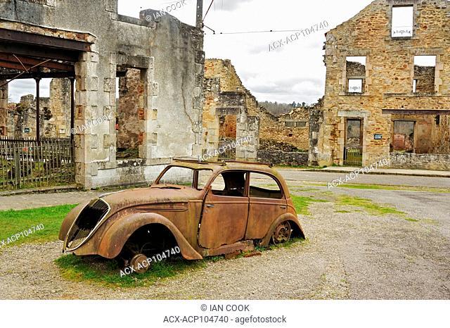 Peugeot 202 car ruins, Oradour-sur-Glane, Haute-Vienne Department, Limousin, France