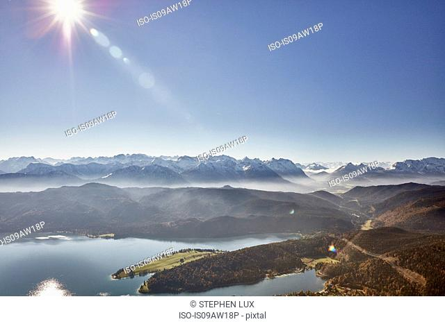 High angle view of sunlit mountains and lake Walchen, Bavaria, Germany