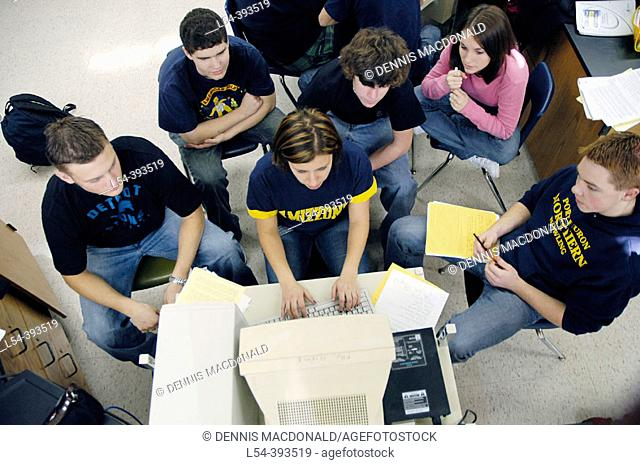 Groups of high school students meet in a computer laboratory to work as a team on a software project