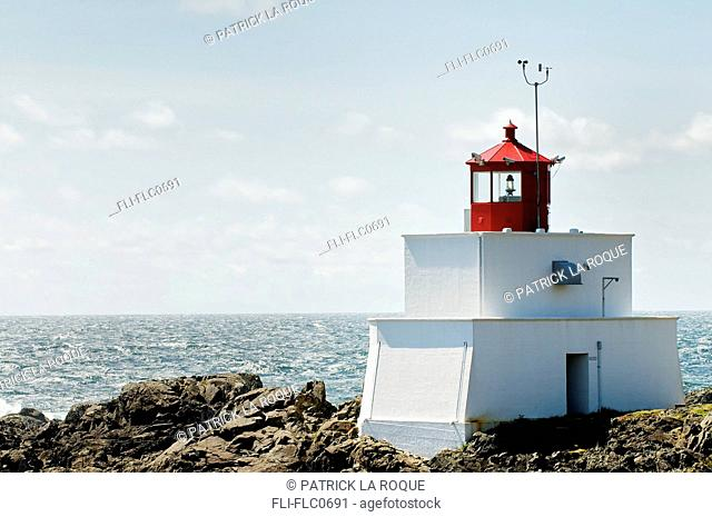 Red and white lighthouse on a sunny day, Wild Pacific Trail, Ucluelet, British Columbia, Canada