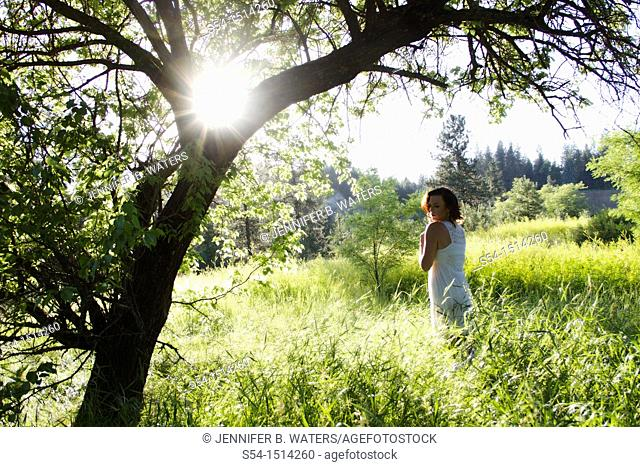A young caucasian woman outdoors in a park in Spokane, Washington, USA