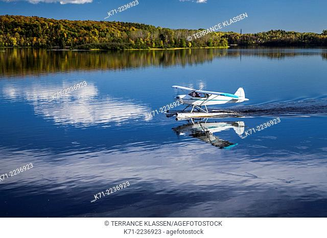A seaplane landing on the Saint-Maurice River in Shawinigan, Quebec, Canada