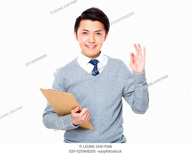 Asian Businessman hold with clipboard and ok sign gesture