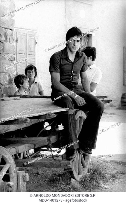 Portrait of Francesco Moser on a cart. Portrait of Italian racing cyclist Francesco Moser sitting on a cart. Palù, August 1975