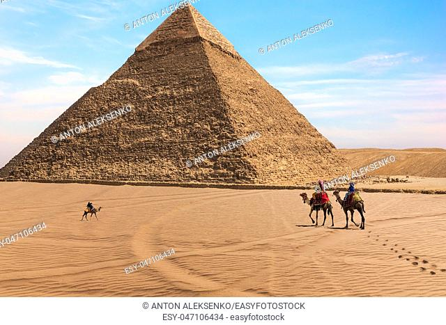 The Pyramid of Chephren and bedouins in the desert of Giza, Egypt