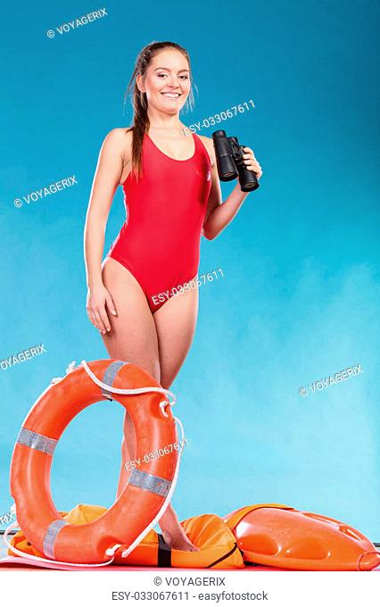 678d6d9bbefa Happy lifeguard with ring buoy lifebuoy and binoculars. Woman girl  supervising swimming pool water on