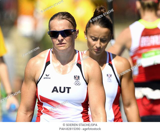 Yvonne Schuring (L) and Ana-Roxana Lehaci of Austria react after the Women's Kayak Double 500m Heats of the Canoe Sprint events during the Rio 2016 Olympic...