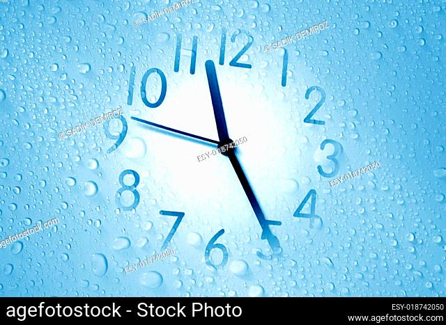 clock on waterdrop background