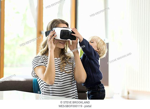 Mother with son wearing Virtual Reality Glasses