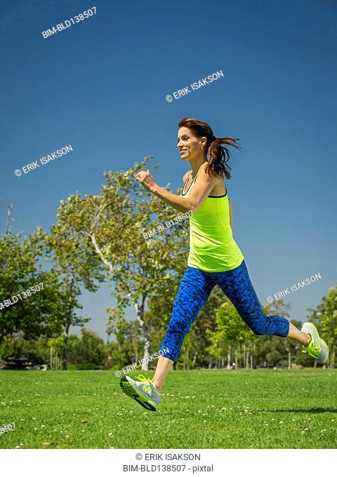 Mixed race woman jogging in park