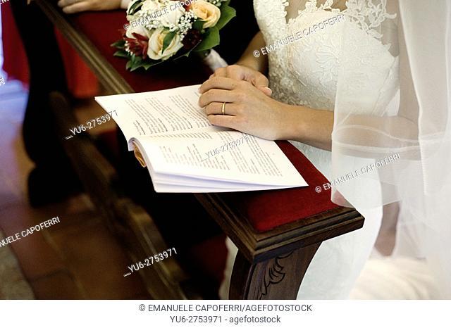 Bride's hands in church