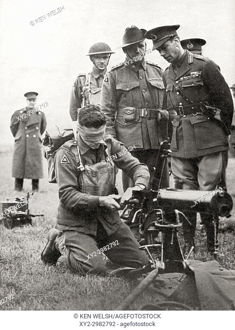King George VI watching a blindfolded Australian soldier assemble a machine gun, 1940. George VI, 1895 - 1952. King of the United Kingdom and the Dominions of...