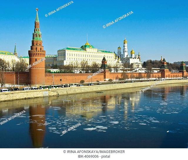 Moscow Kremlin with palace and cathedrals on bank of Moskva River in spring, ice on the water, Moscow, Russia