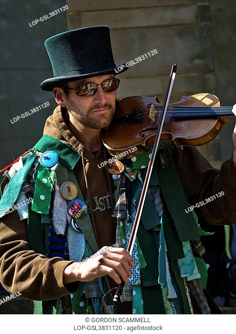 England, Kent, Rochester. A musician from Green Dragon Morris playing a violin at the annual Sweeps Festival in Rochester