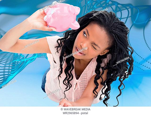 Broke black woman looking on piggy-bank . empty pocket concept. blue and lights background