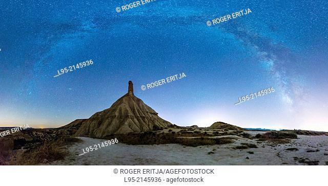 Most renowned cliff eroded by rainfall, symbol of the clay-only area of the natural park of Bardenas Reales de Navarra, Navarre, Spain, at night with Milky Way