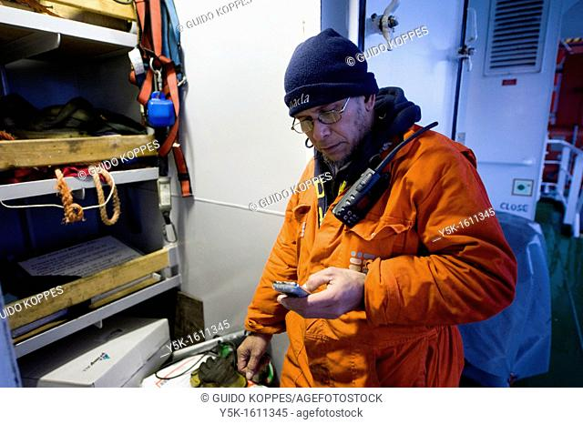 An Indonesian seaman or sailor on the container-vessel MV Flintercape, during a journey from Rotterdam, Netherlands, to Sundsvall, Sweden