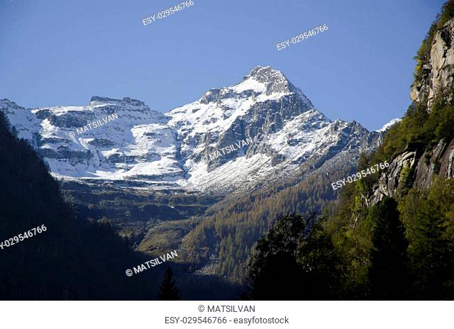 Snow-capped mountain with blue sky