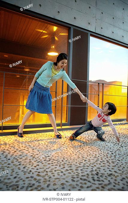 Scared Boy Pulling His Mother's Hand