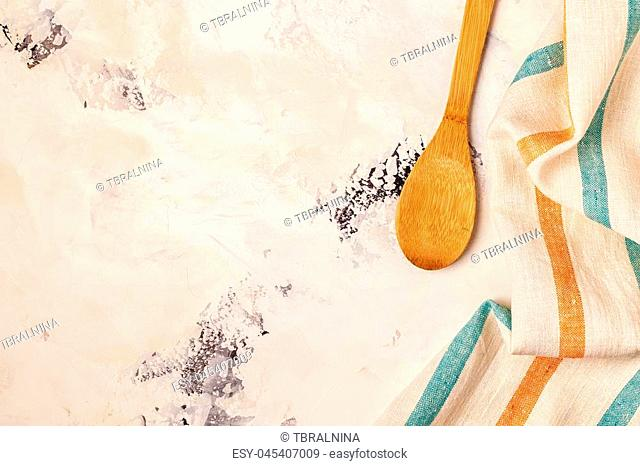 Kitchen background with towel and cooking tools, top view, copy space