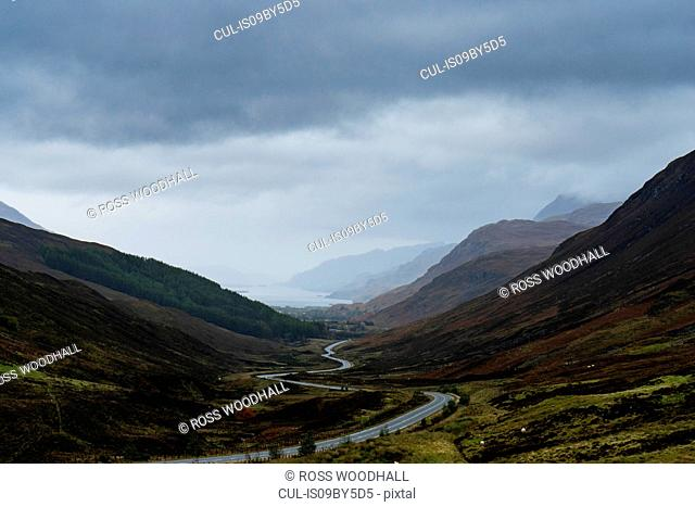 Mountain landscape with winding rural road, Achnasheen, Scottish Highlands, Scotland