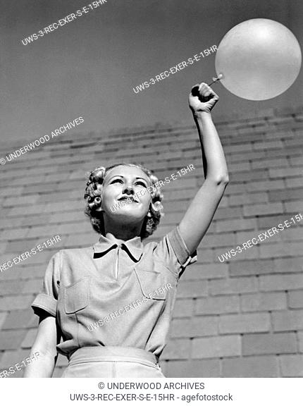 Los Angeles, California: c. 1931 Actress Evelyn Knapp introduces the novel idea of exercises with a balloon on an elastic string
